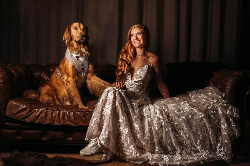 bride sitting next to her dog