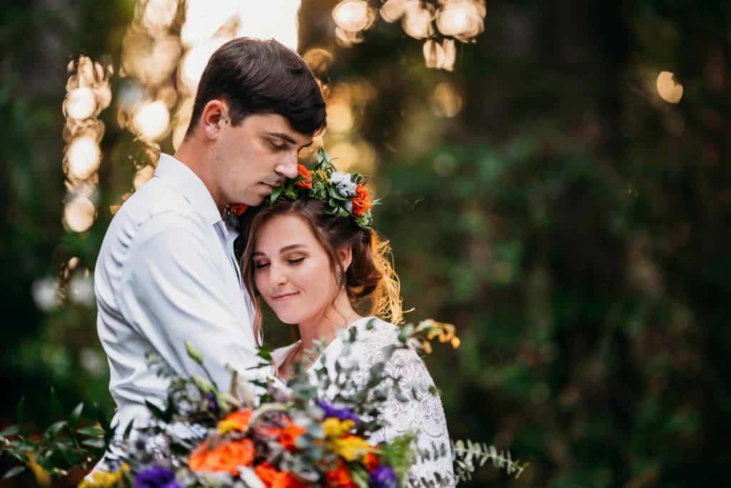cuddling bride and groom at sunken gardens